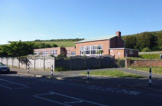 The site of the new building, in Upper Ventnor, backing onto the Downs